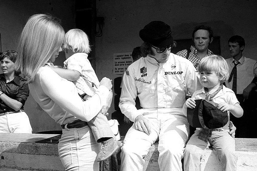 """The Stewarts were a glamorous couple on the racing circuit in the 1960s and 1970s. """"She was a big part of my motor racing career,"""" he says of Lady Helen. Sir Jackie and Lady Helen with their two sons Paul (right) and Mark. The couple, who have been m"""