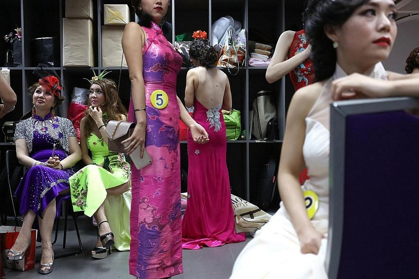 Contestants dressed in cheongsams - and one in a sari - posing for a photo before the start of the finals of the Singapore Qipao Society's inaugural pageant at the Axis Theatre at Textile Centre on Friday night. Established last year, the society aim