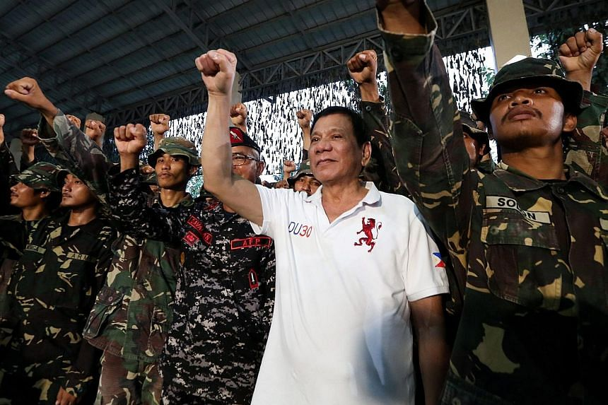 Mr Duterte visiting the Philippine Army Scout Rangers at their headquarters in the town of San Miguel on Thursday.