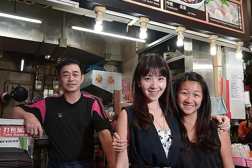 Ms Teo (centre) at her 55-year-old father Teo Chye Huat's noodle stall with her younger sister Eileen, 23. During her teenage years, Ms Teo struggled with financial worries, including her father's bankruptcy. Now the award-winning wealth planner help