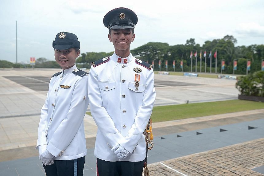 With Second- Lieutenant Brandon Tan Kah Hwee at the Safti Military Institute commissioning parade in Jurong yesterday is 2LT Lee Man Ying, the only woman in her graduating cohort.
