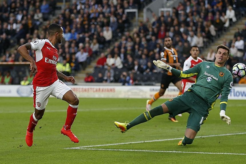Theo Walcott scoring Arsenal's second goal at Hull. The Gunners comfortably defeated 10-man Hull despite Alexis Sanchez missing a penalty. Arsenal won a third consecutive Premier League game for the first time this year.