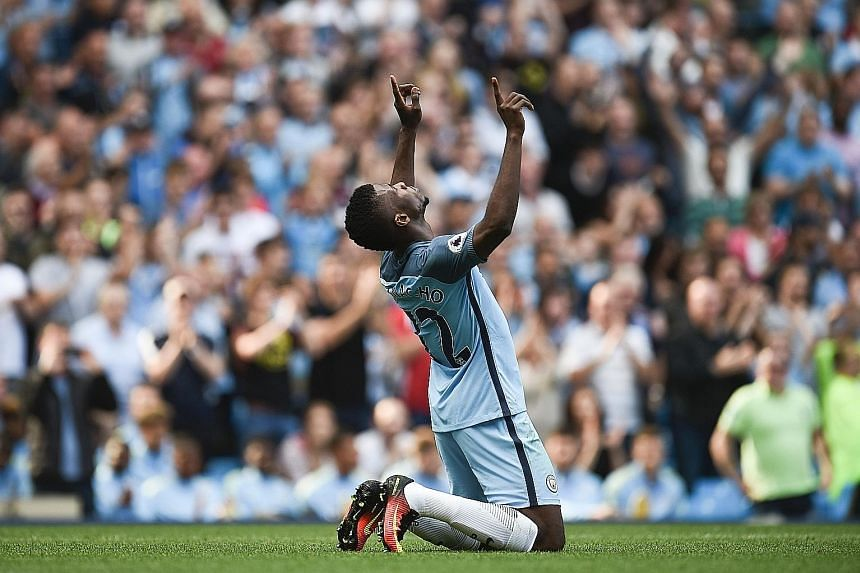 Manchester City striker Kelechi Iheanacho celebrating after scoring their second goal in the 4-0 Premier League win over Bournemouth yesterday. City sit on top of the table with five wins out of five.