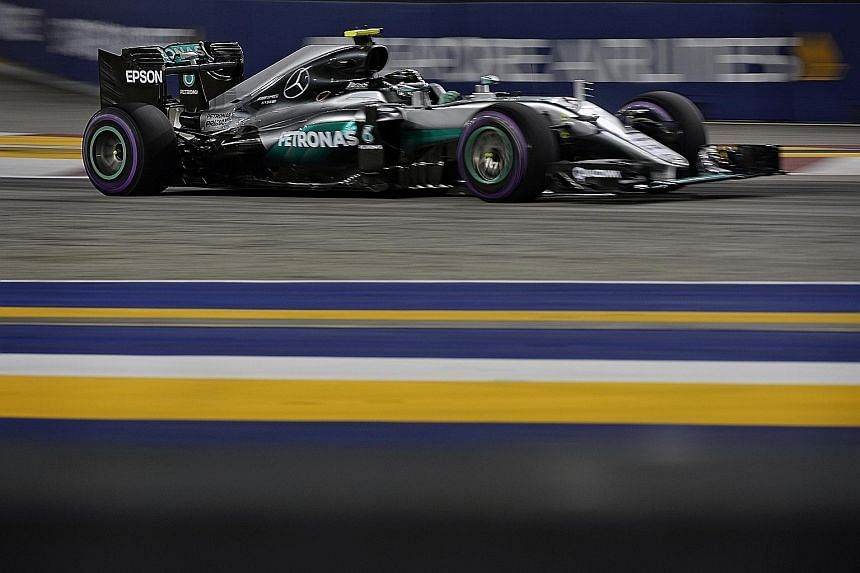 Mercedes driver Nico Rosberg at Turn 22 during qualifying for the Singapore Grand Prix last night. Six times in eight years, the race has been won by drivers at the top of the grid, as the narrow track limits overtaking.
