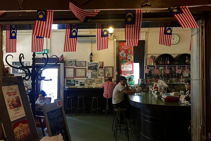 The bar at the original Coliseum outlet retains an old-world charm.