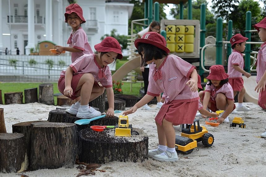 Children from a nursery class at St James' Church Kindergarten at play. The enrolment there bucks the declining trend. Even so, it is considering opening a childcare centre after multiple requests from parents.