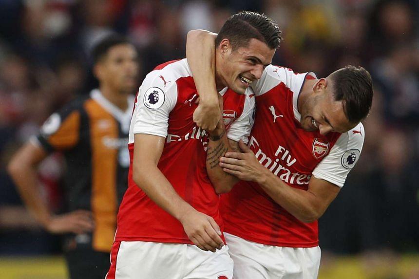 Arsenal's Granit Xhaka celebrates scoring their fourth goal.