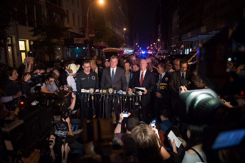 Mayor Bill de Blasio (centre) speaks as NYPD Commissioner James O'Neill (left) looks on during a press conference dealing with an explosion earlier in the evening on West 23rd Street on Sept 17, 2016, in New York.