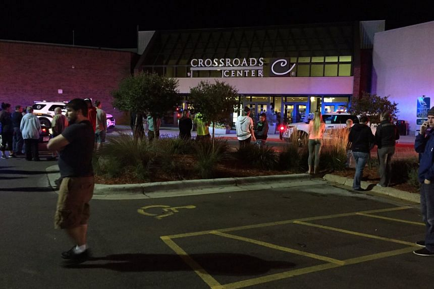 People evacuate and police arrive at the Crossroads Centre mall in Minnesota, where the stabbings took place.