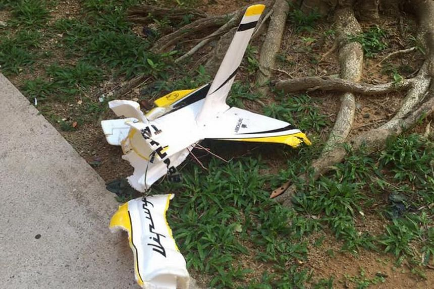 The wreckage of a model plane that crashed into a HDB block in Bishan lying on the ground after the accident, on Sept 16, 2016.