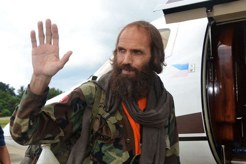 Freed Norwegian national Kjartan Sekkingstad waving as he prepares to board a plane at Jolo airport, Mindanao, on Sept 18, 2016.
