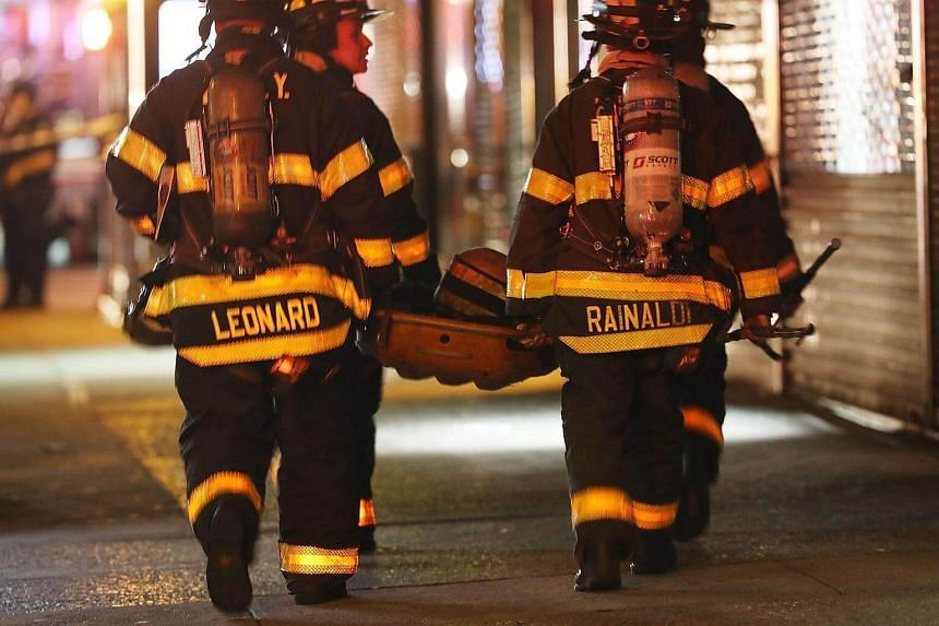 Firefighters in action at the scene of the explosion in Chelsea neighbourhood, Manhattan, New York, on Sept 17, 2016.