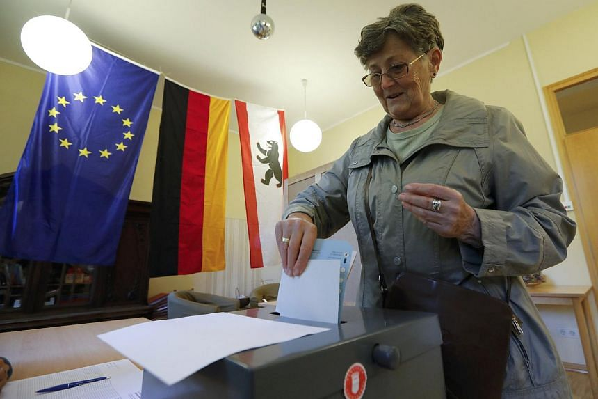 A woman casts her vote during the state election in Berlin on Sunday.