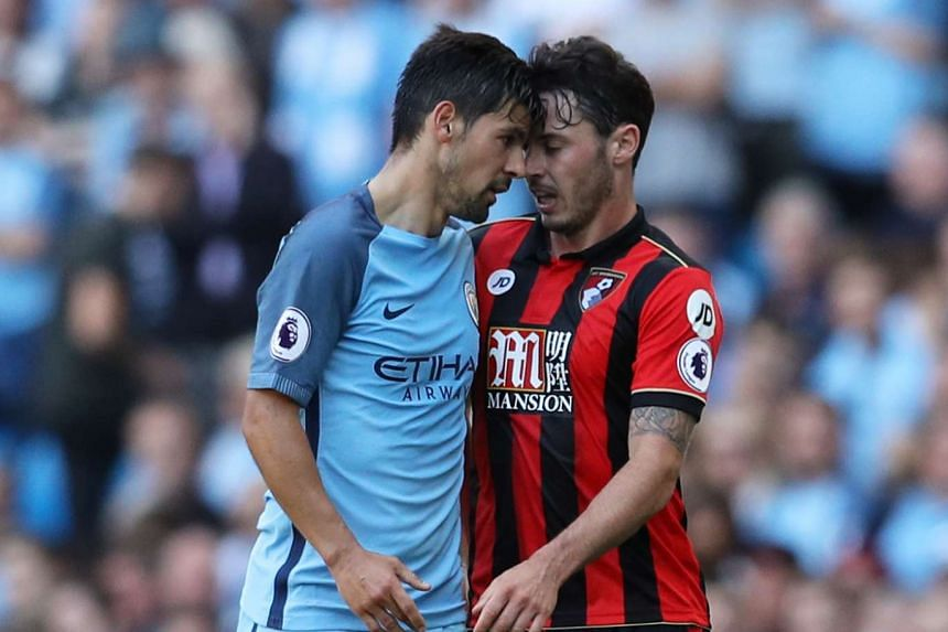 Manchester City's Nolito headbutts Bournemouth's Adam Smith resulting in a red card.
