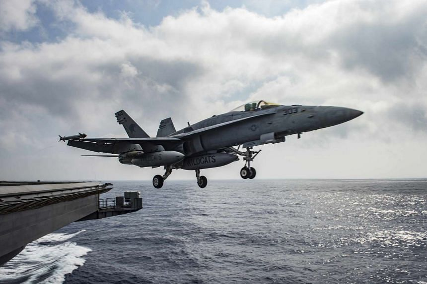 A Super Hornet jet launches from the deck of a US aircraft carrier in the Mediterranean Sea on June 28, 2016.