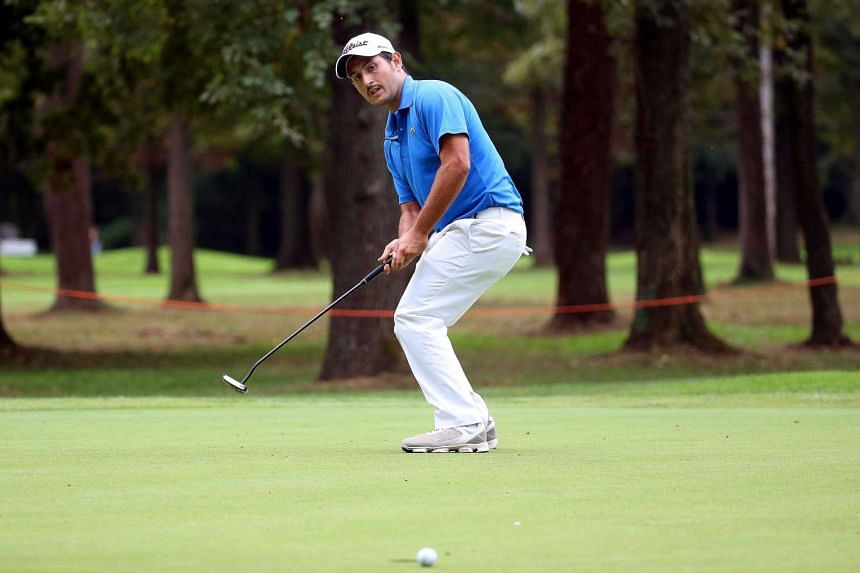 France's Alexander Levy plays a shot on the third day of the Italian Open golf tournament.