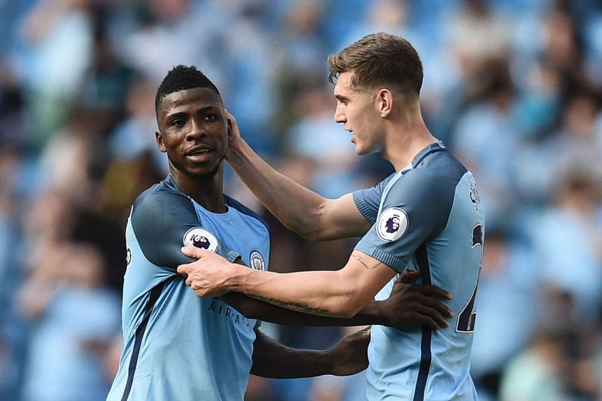 Manchester City striker Kelechi Iheanacho (left) and defender John Stones celebrate at the end of the match.