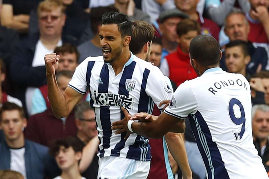 West Bromwich Albion's Nacer Chadli celebrates scoring their first goal.