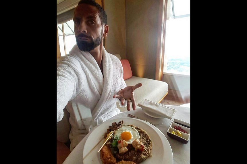 Former Manchester United defender Rio Ferdinand tweeted a photo of himself eating nasi goreng in Singapore.