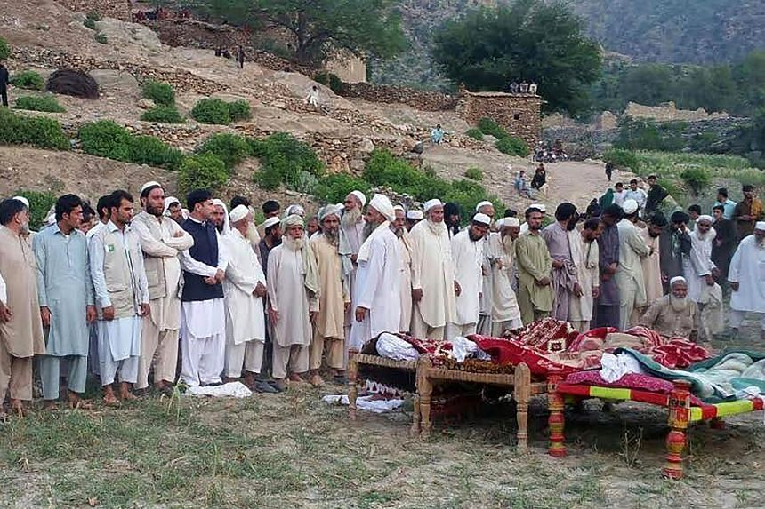 Pakistani mourners gather for the funeral prayers of the victims of a suicide bombing in Bajaur Agency near the Pakistan-Afghanistan border, on Sept 17, 2016.