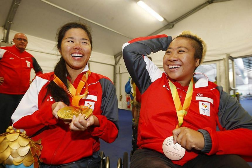 Yip Pin Xiu (left) and Theresa Goh celebrating their medals.
