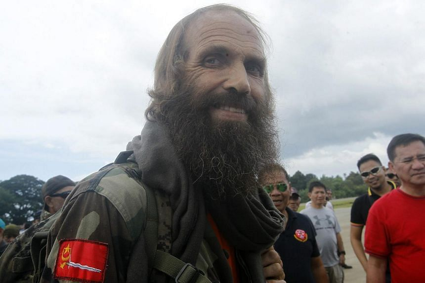 Kjartan Sekkingstad boarding an airplane at an airport following his release in the town of Jolo, Sulu province, on Sept 18, 2016.