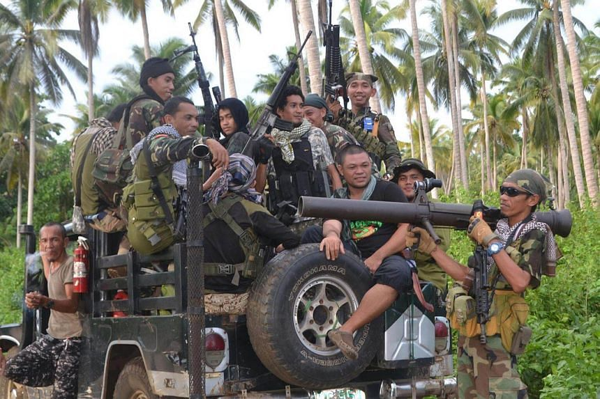 MNLF rebels aboard a vehicle. Three Indonesian nationals were released to the MNLF by their Abu Sayyaf captors in the southern Philippine province of Sulu on Saturday (Sept 17) night.
