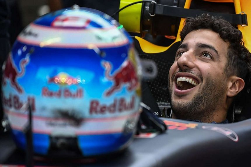 Red Bull's Daniel Ricciardo sits inside his car during the third practice session on Sept 17, 2016.