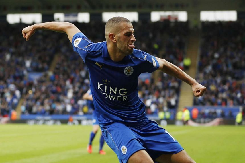 Leicester City's Islam Slimani celebrates scoring their first goal.