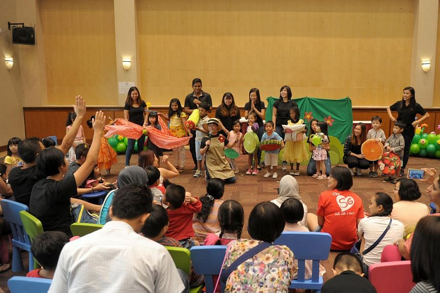Early childhood expert Low Siew Hong (kneeling) performing a puppet show at the launch of the Play programme on Sept 18, 2016.