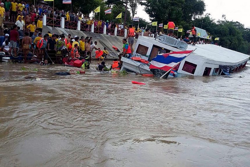Thai rescuers working to help survivors of a submerged ferry after an accident on the Chao Phraya river in Ayutthaya province on Sept 18, 2016.