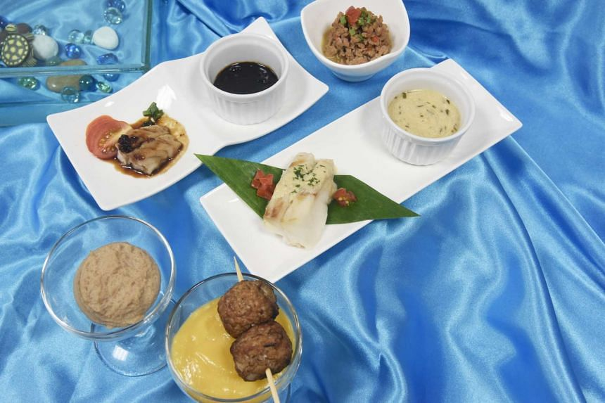 Dishes include (from top) Coarsely Minced Kicap Fish, Coarsely Minced Steamed Fish with Oriental Sauce, Blended Braised Ginseng Chicken and Coarsely Minced Chicken Pattie with Orange Cheese Sauce.