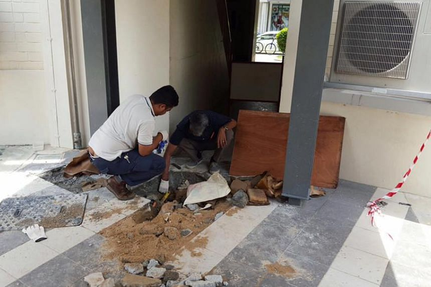 Workers fixing damaged pipes at Block 508, Tampines Central 1.