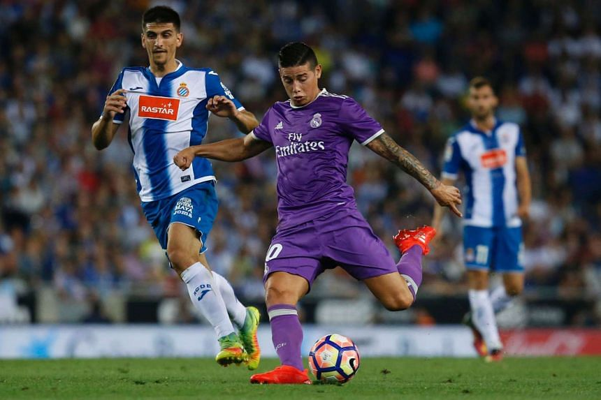 Real Madrid's James Rodriguez kicks the ball to score during their Spanish league football match against RCD Espanyol on Sept 18, 2016.