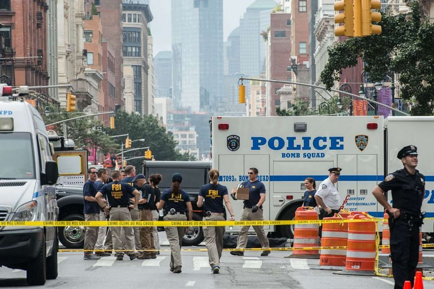 FBI agents review the crime scene of remnants of bomb debris on 23rd Street in Manhattan's Chelsea neighborhood on Sept 18, 2016 in New York City.