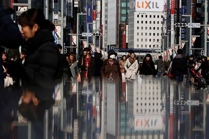 People walk on a street at Tokyo's Ginza shopping district.