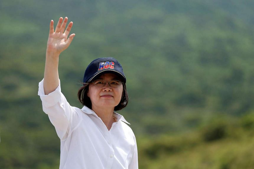 Taiwanese President Tsai Ing-wen waves after the annual Han Kuang military drill simulating the China's People's Liberation Army invading the island, in Pingtung county, southern Taiwan.