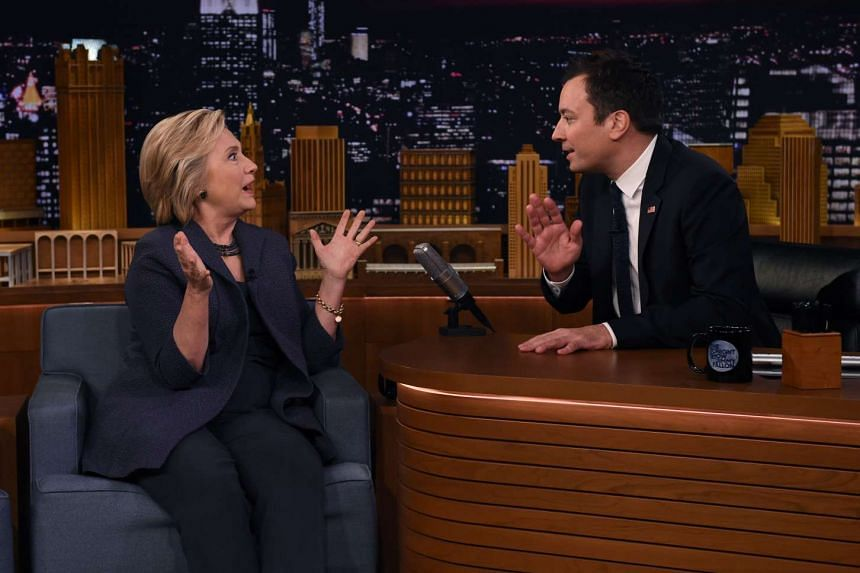 Democratic presidential nominee Hillary Clinton speaks with talk show host Jimmy Fallon.