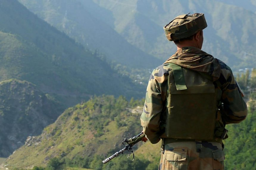 An Indian army soldier looking on near the site of the gunfight at the border with Pakistan, in Uri on Sept 18, 2016.