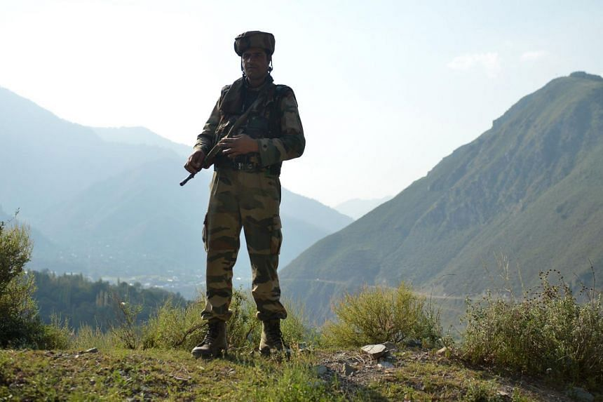 An Indian army soldier stands guard near the site of a gun battle between Indian army soldiers and rebels inside an army brigade headquarters near the border with Pakistan,on Sept 18, 2016.