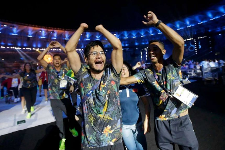 Brazilian athletes take part in the closing ceremony. It is the end of 11 days of sporting action at the Rio Paralympics, yet the raucous cheers of cariocas (the locals of Rio de Janeiro) have not died down.