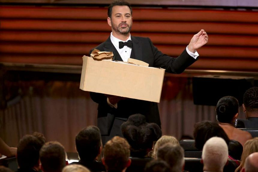 Show host Jimmy Kimmel hands out sandwiches to the audience at the 68th Primetime Emmy Awards in Los Angeles on Sept 18, 2016.