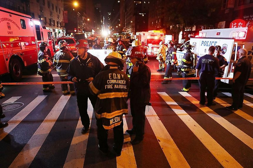 "Emergency workers at the scene of the explosion in New York City on Saturday night. New York Governor Andrew Cuomo has called the powerful explosion that injured 29 people ""an act of terrorism"", but said no link to international groups had been found"