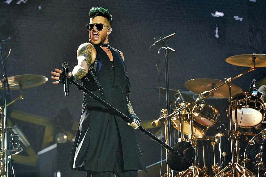 American singer Adam Lambert (above) shone with his flamboyant take on Queen's songs.