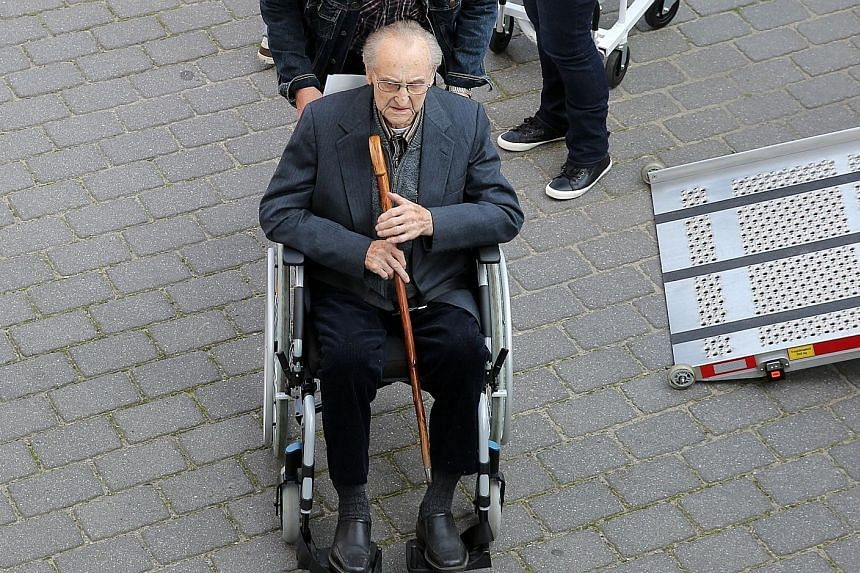 Former SS medic Hubert Zafke, 95, arriving for his trial last week in Neubrandenburg, Germany. He is accused of complicity in the murders of 3,681 inmates at Auschwitz concentration camp in Poland during World War II. Observers say these belated tria