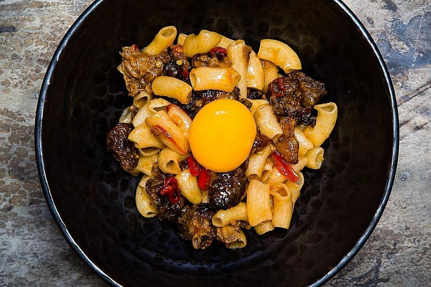Among the 10 dishes chef Mitchell Orr served at a guest cooking stint in Singapore recently were Macaroni, Pig's Head, Egg Yolk (above) and Baloney Sandwich.
