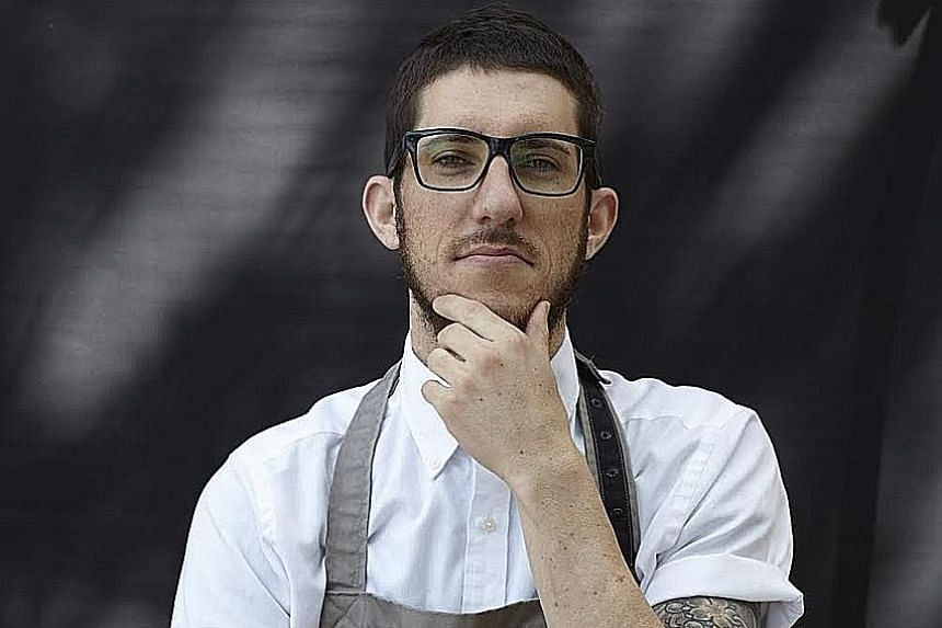 Among the 10 dishes chef Mitchell Orr (above) served at a guest cooking stint in Singapore recently were Macaroni, Pig's Head, Egg Yolk and Baloney Sandwich.