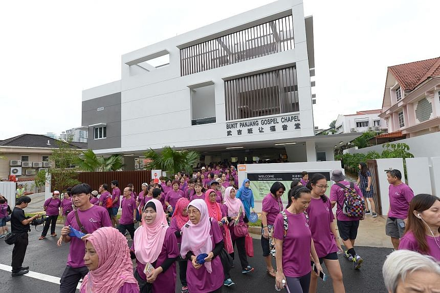 Participants of the Inter-Racial and Religious Confidence Circle Walk-In-Harmony at Bukit Panjang Gospel Chapel yesterday. More than 3,000 people from nine constituencies took part in the walk.