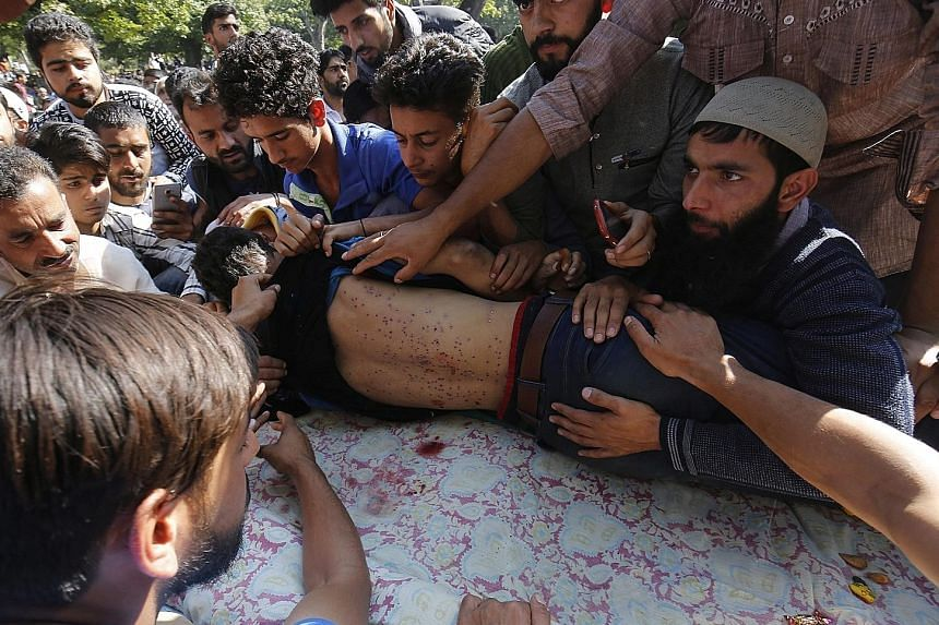 The funeral of schoolboy Nasir Shafi Qaz was held in New Theed village yesterday. His body was found riddled with pellets last Friday after clashes between demonstrators and security forces.