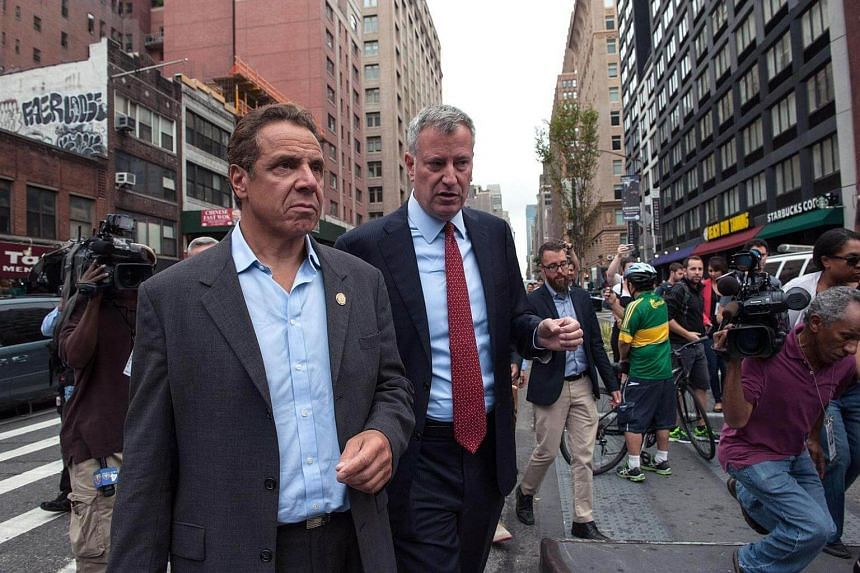 New York governor Andrew Cuomo (left) and city mayor Bill de Blasio tour the site of the bomb blast on 23rd Street in Manhattan's Chelsea neighbourhood on Sept 18, 2016 in New York City.